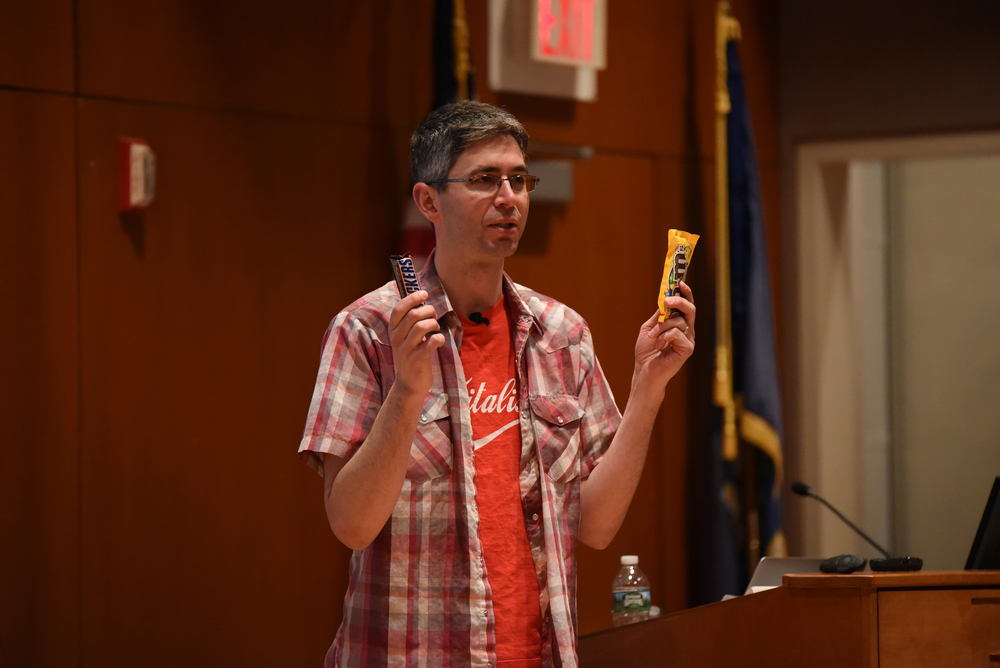 Dr. Yoram Bauman performs his comedy routine in the Thomas J. Dodd Research Center's Konover Auditorium in Storrs, Connecticut on Thursday, March 3, 2016. (Allen Lang/The Daily Campus)