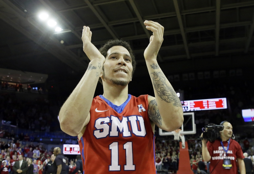 SMU guard Nic Moore (11) claps after an NCAA college basketball game against UConn Thursday, March 3, 2016, in Dallas. SMU won 80-54. (AP Photo/LM Otero)