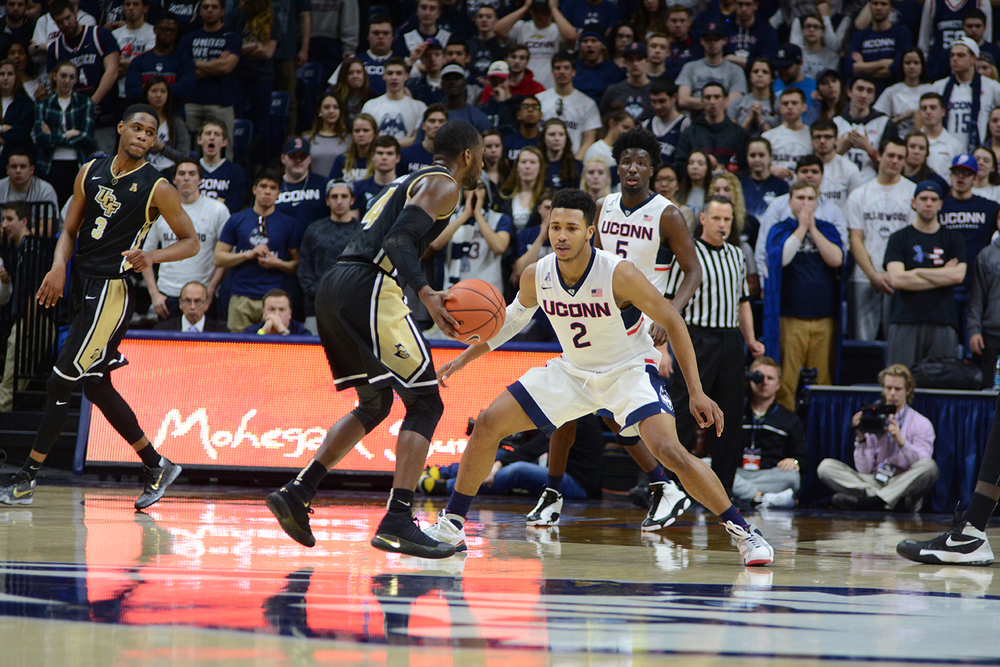 Jalen Adams gets into a defensive position during UConn's 67-46 victory over UCF at Gampel Pavilion on Sunday March 6, 2016. Adams finished with seven points. (Matthew Zabierek/The Daily Campus)