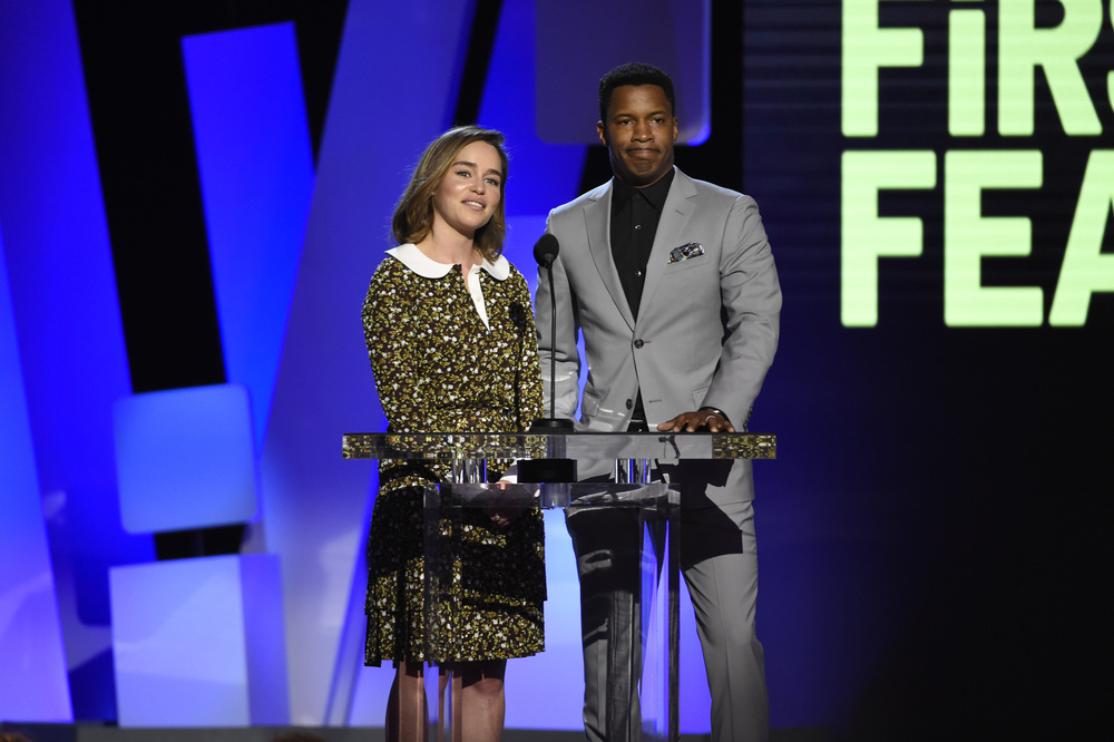 "Emilia Clarke, left, and Nate Parker present the award for best first feature at the Film Independent Spirit Awards on Saturday, Feb. 27, 2016, in Santa Monica, Calif. Turner's film ""Birth of a Nation,"" set to be released later this year, is already garnering acclaim. (Photo by Chris Pizzello/Invision/AP)"