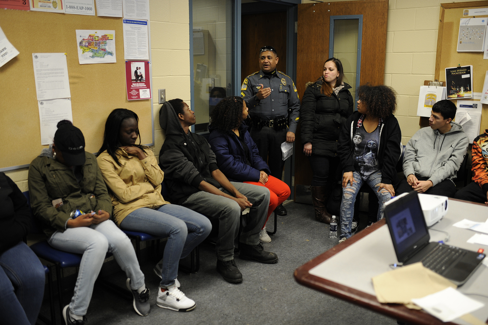 A member of the UConn Police Department speaks with high school students during an outreach event the department hosted at its station in Storrs, Connecticut on Saturday, March 5, 2016. (Jason Jiang/The Daily Campus)
