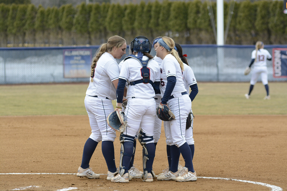 Members of the UConn softball team have a mound visit in game last season. The Huskies won one game in the Gamecock Invitational hosted by South Carolina over the weekend. (Jason Jiang/The Daily Campus)