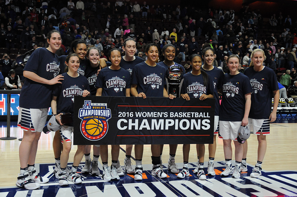 The UConn women's basketball team poses with the American Athletic Conference tournament trophy after winning it for the third consecutive year. (Bailey Wright/The Daily Campus)