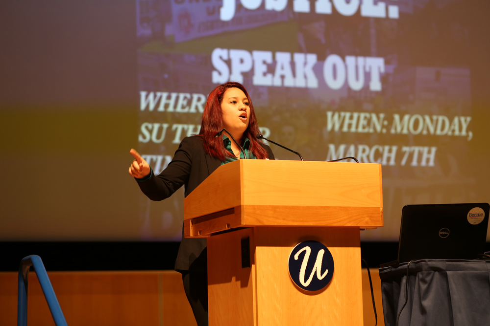 Daniela Doncel, a second-semester French and pre-journalism major, speaks at the Students Without Borders' Speak Out event in the Student Union Theater on Monday night, March 7, 2016. (Jackson Haigis/The Daily Campus)