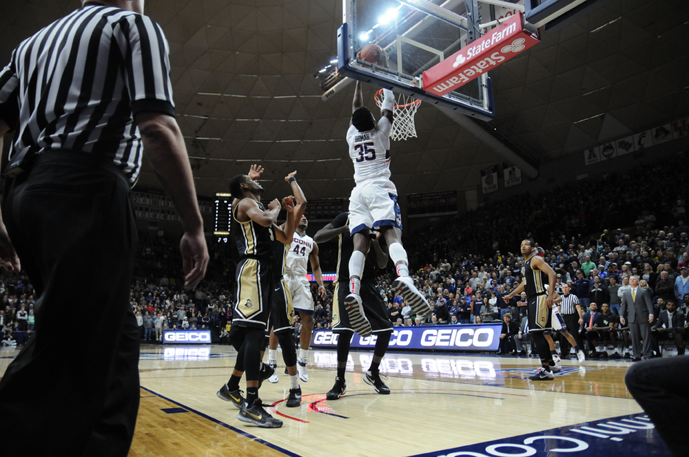 Amida Brimah slams home a dunk during UConn's 67-46 victory over UCF at Gampel Pavilion on Sunday March 6, 2016. UConn is next in action on Friday in the quarterfinals of the American Athletic Conference tournament. (Bailey Wright/The Daily Campus)