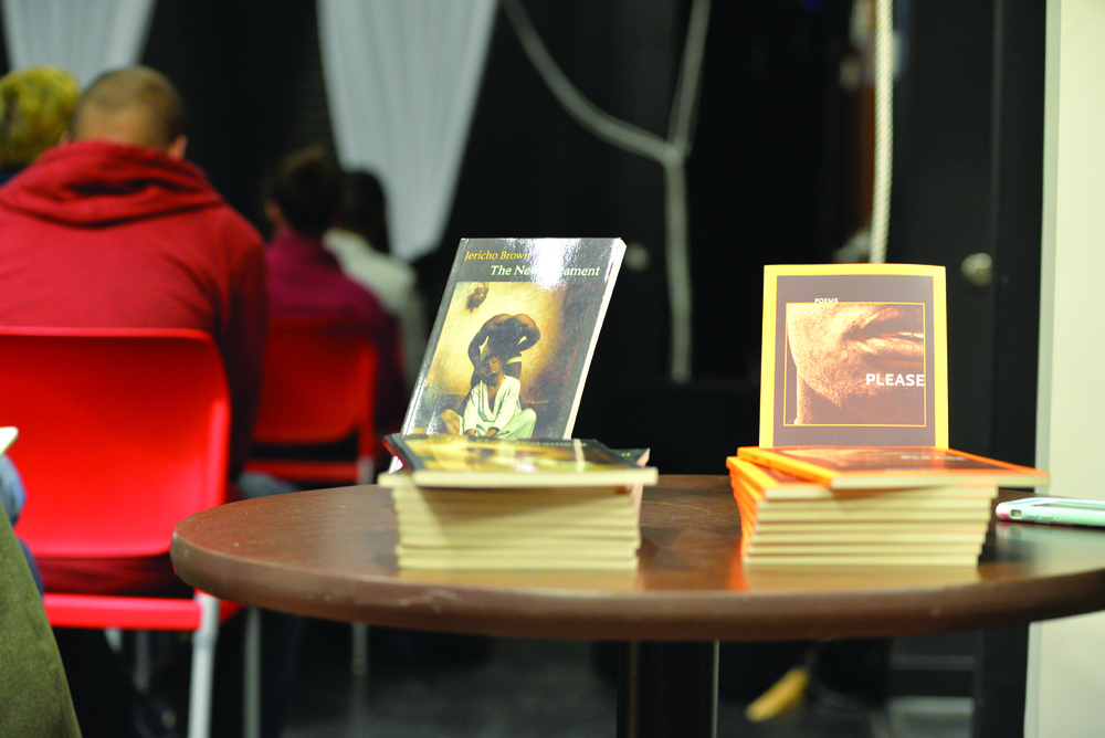 "Jericho Brown's books, ""New Testament"" and ""Please,"" at the event. Students were overwhelmingly pleased with his reading, calling it ""moving."" (Amar Batra/Daily Campus)"