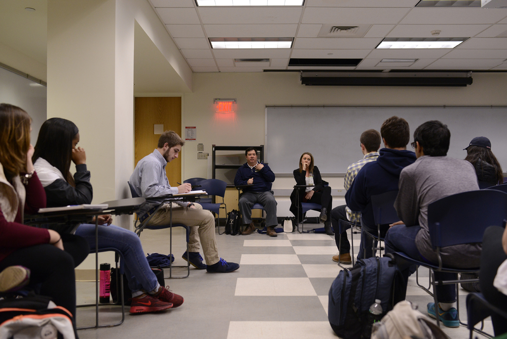 Panelists Dan Lee '10 MA (right) and Kelsey Hahn '14 (far left) talk about their experiences in the sports industry after graduating from UConn. (Jason Jiang/Daily Campus)