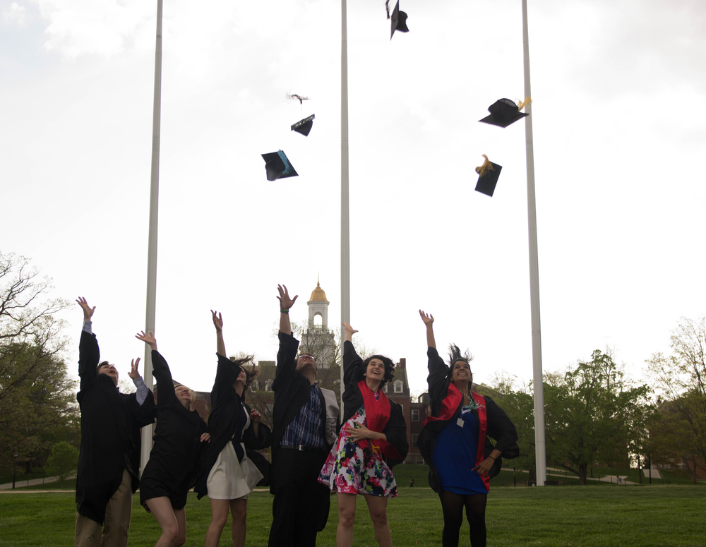 Members of the class of 2015 throw their hats into the air on the Great Lawn in front of Wilbur Cross. The class of 2020 is still accepting members, post-January 15 application deadline, said Nathan Fuerst, direcot of admissions. According to Fuerst, It's normal for schools to accept late applications. (Amar Batra/Daily Campus)