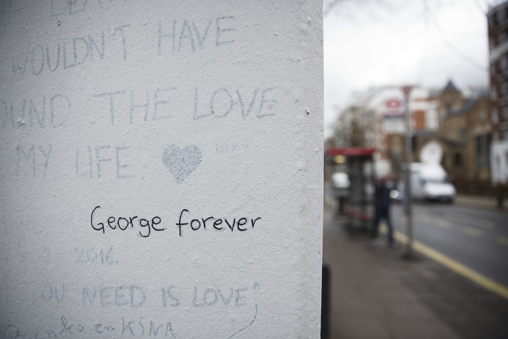 "The words ""George forever"" are seen written on a wall outside Abbey Road studios where the Beatles recorded albums and where the zebra crossing cover picture of the Abbey Road album was originally taken in London, Wednesday, March 9, 2016. George Martin, the Beatles' urbane producer who quietly guided the band's swift, historic transformation from rowdy club act to musical and cultural revolutionaries, has died, his management said Wednesday March 9, 2016. He was 90. (AP Photo/Matt Dunham)"