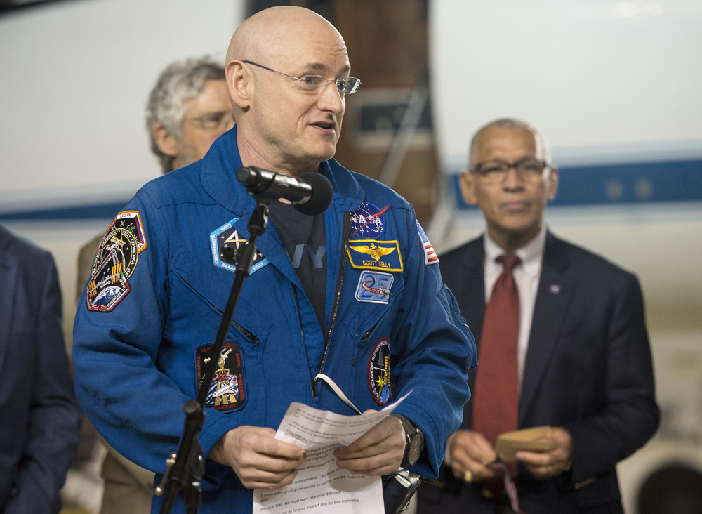 Expedition 46 Commander Scott Kelly of NASA delivers remarks upon arriving at Ellington Field, Thursday, March 3, 2016 in Houston, Texas, after his return to Earth. (Joel Kowsky/NASA via AP)