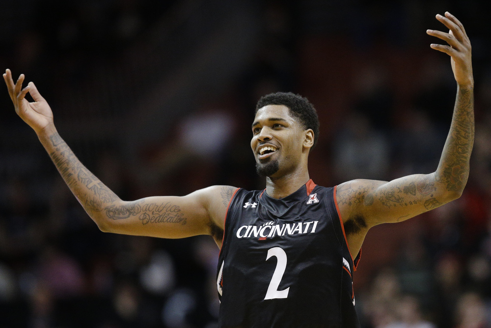 Cincinnati's Octavius Ellis (2) celebrates after scoring during the first half of an NCAA college basketball game against SMU, Sunday, March 6, 2016, in Cincinnati. (AP Photo/John Minchillo)