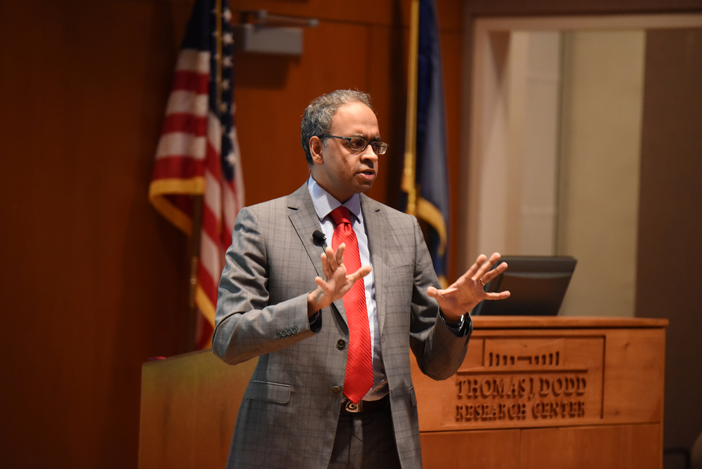 Author and Hunter College professor of history Manu Bhagavan speaks during his lecture at the Thomas J. Dodd Center's Konover Auditorium in Storrs, Connecticut on Thursday, March 10, 2016. (Allen Lang/The Daily Campus)