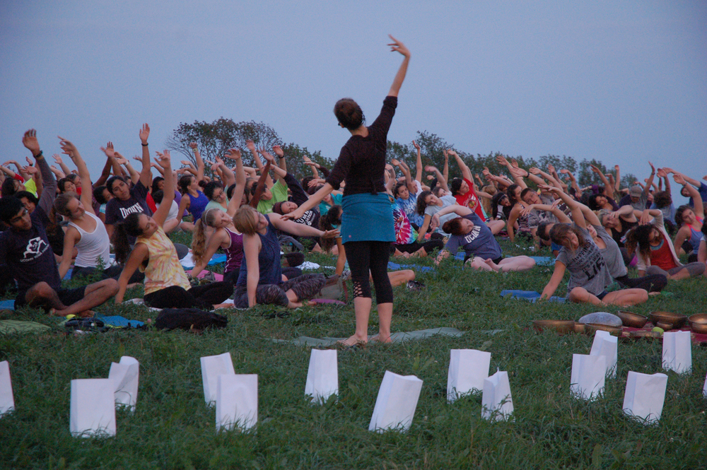 Students participate in sunset yoga and gong meditation on Horsebarn Hill on Friday, Sept. 4, 2015. The event was part of National Suicide Prevention Week, and was sponsored by UConn's Counseling and Mental Health Services. (Erika Elechicon/The Daily Campus)