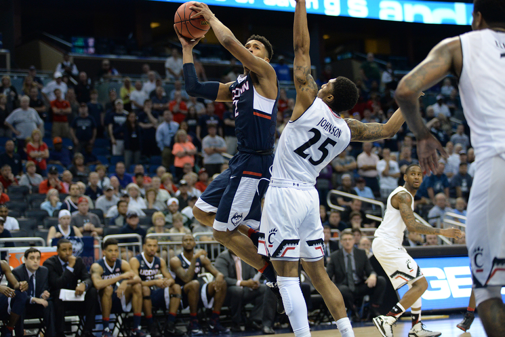 Jalen Adams attacks the basket and goes up for a layup during UConn's 104-97 four overtime victory over Cincinnati in the quarterfinals of the American Athletic Conference Championship at the Amway Center in Orlando, Florida on Friday March 11, 2016. Adams scored a career high 22 points. (Ashley Maher/The Daily Campus)