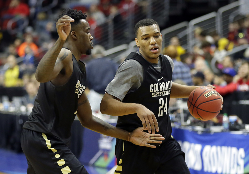 Colorado guard George King, right, drives past teammate Wesley Gordon during practice for a first-round men's college basketball game in the NCAA Tournament, Wednesday, March 16, 2016, in Des Moines, Iowa.Colorado will play Connecticut on Thursday. (AP Photo/Charlie Neibergall)
