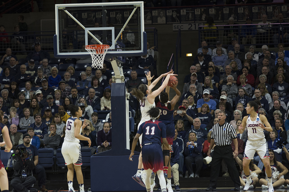 Senior forward Breanna Stewart blocks a shot during UConn's 101-49 victory over Robert Morris in the first round of the NCAA tournament at Gampel Pavilion on Saturday March 19, 2016. Stewart became UConn's all-time leader in blocked shots, passing Rebecca Lobo. Stewart's three blocks against Robert Morris pushed her career total to 398. (Bailey Wright/The Daily Campus)