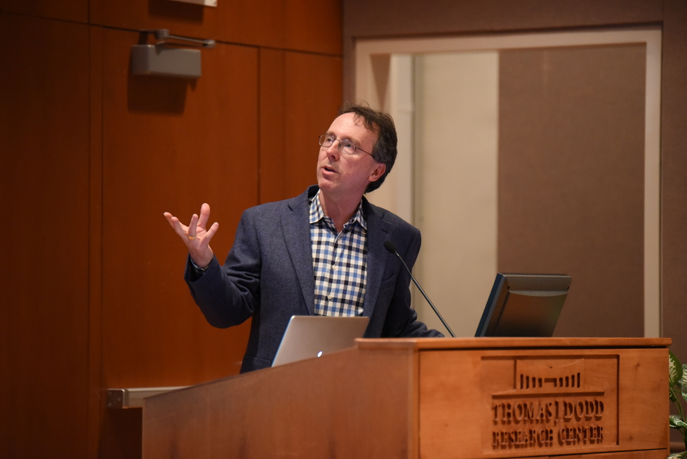 "Sports Illustrated writer Alexander Wolff gives a lecture on his book ""The Audacity of Hoop"" in the Konover Auditorium at the Dodd Center on Monday, March 22. (Zhelan Lang/The Daily Campus)"