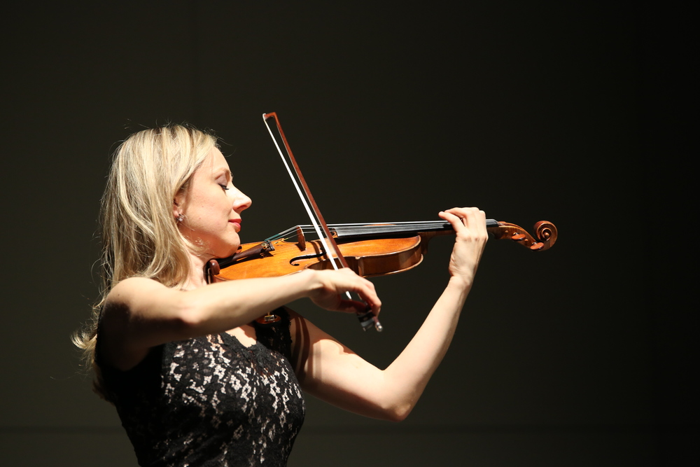 Violinist Solomiya Ivakhiv performs a piece at the Jorgensen Center for Performing Arts on Monday, March 22. Ivakhiv is an assistant professor of violin and viola and head of strings at the University of Connecticut. (Tyler Benton/The Daily Campus)