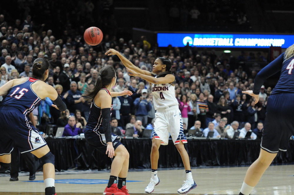 Moriah Jefferson (4) passes the ball during the a 97-51 victory against Duquesne in the Round of 32 on Monday, March 22 at Gampel Pavilion. Jefferson scored 20 points and had seven assists and four rebounds in her final game at Gampel. (Bailey Wright/The Daily Campus)