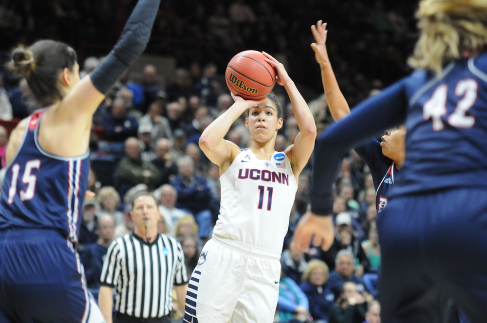 Sophomore guard Kia Nurse (11) takes a shot against Duquesne in the second round of the NCAA tournament on Monday, March 22 at Gampel Pavilion. She scored seven points with three rebounds en route to a 97-51 victory. (Bailey Wright/The Daily Campus)