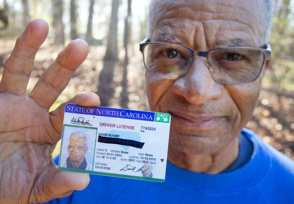 David Boger blacked out his address on a drivers license to protest the new North Carolina Voter ID law as he cast his ballot in Greensboro, NC on Tuesday, March 15, 2016. On Aug. 13, North Carolina Gov. Pat McCrory signed intolaw a voter ID bill that mandates a government-issued photo and reduced the state's early voting period from 17 to 10 days. (H. Scott Hoffmann/News & Record via AP)