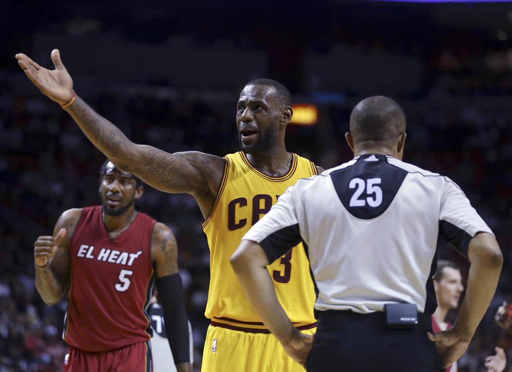 Cleveland Cavaliers forward LeBron James (23) talks with official Tony Brothers (25) during the second half of an NBA basketball game against the Miami Heat, Saturday, March 19, 2016, in Miami. (AP Photo/Lynne Sladky)
