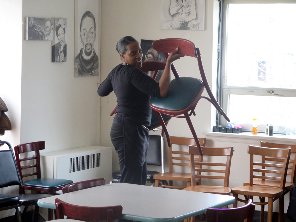 Laurie Thurman, who co-owns Coffee Makes You Black, a well-known breakfast spot on Milwaukee's predominantly African-American north side, shown Friday, March 18, 2016 in her Milwaukee shop. Thurman hasn't decided whether she will vote for Democratic Presidential candidates Hillary Clinton or Bernie Sanders in the upcoming Wisconsin presidential primary. She's leaning toward Clinton, but she said she was surprised to learn her husband is voting for Sanders. (AP Photo/Greg Moore)