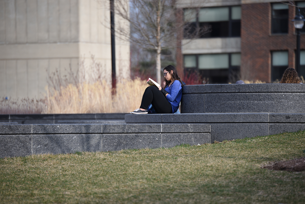 As spring comes, students tend to enjoy reading outdoors. (Zhelun Lang/The Daily Campus)