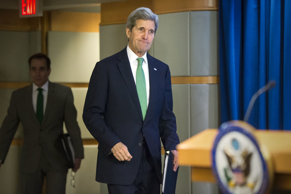 Secretary of State John Kerry arrives to deliver a statement that the U.S. has determined that ISIS is responsible for genocide against religious minority groups in areas under its control including Yazidis, Christians and Shiite Muslims, at the State Department in Washington, Thursday, March 17, 2016. (AP Photo/J. Scott Applewhite)