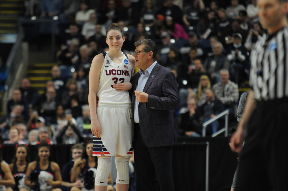 UConn women's basketball forward Katie Lou Samuelson stands with head coach Geno Auriemma during the Huskies' NCAA tournament game against No. 5 Mississippi State at Webster Bank Arena in Bridgeport, Connecticut on Saturday, March 26, 2016. (Bailey Wright/The Daily Campus)