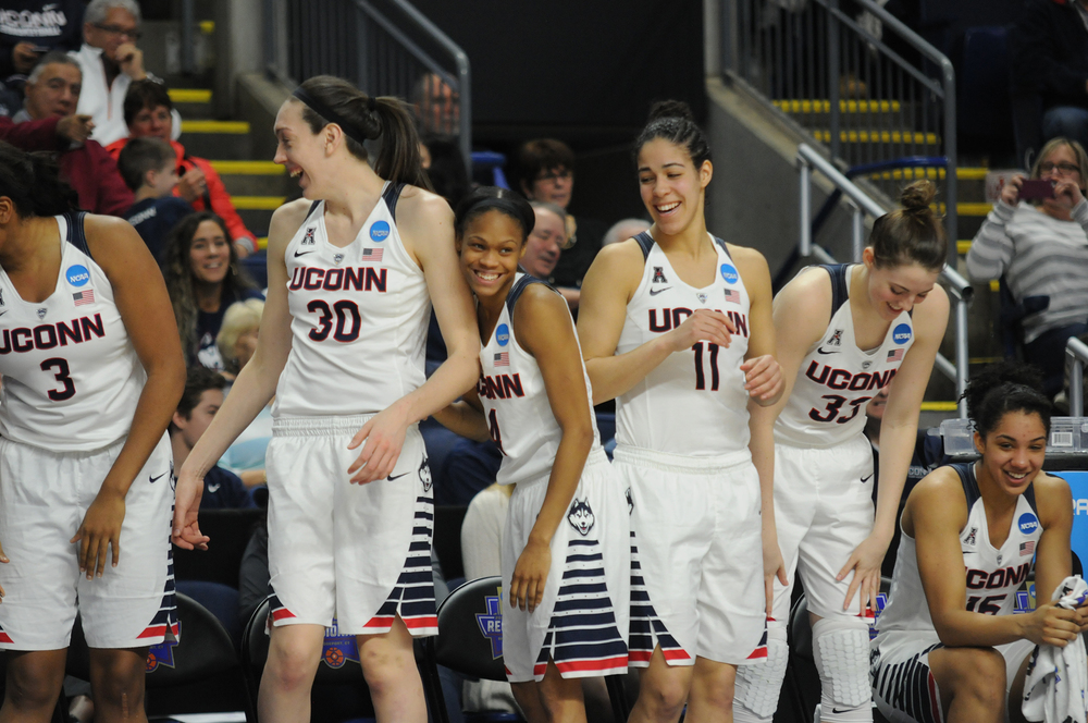 Left to right: UConn women's basketball players Morgan Tuck, Breanna Stewart, Moriah Jefferson, Kia Nurse, Katie Lou Samuelson and Gabby Williams celebrate on the bench during the Huskies' NCAA tournament game against No. 5 Mississippi State at Webster Bank Arena in Bridgeport, Connecticut on Saturday, March 26, 2016. (Bailey Wright/The Daily Campus)