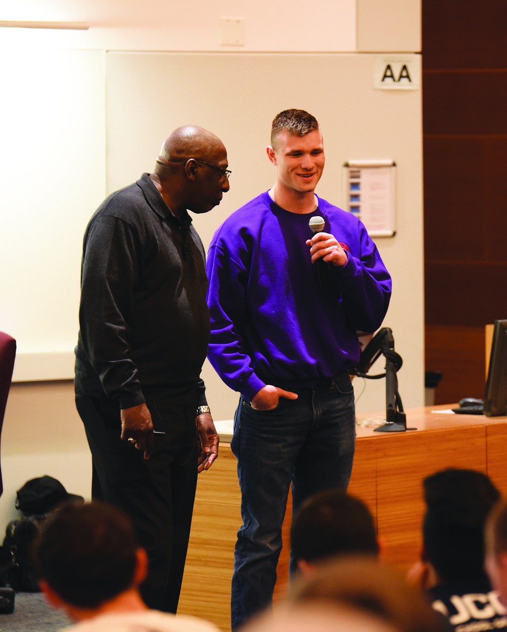 To demonstrate his point, TED Talk host, activist and educator Tony Porter asked a young man to share his personal experience love in his lecture on Tuesday, March 29, 2016. (Zhelun Lang/Daily Campus)