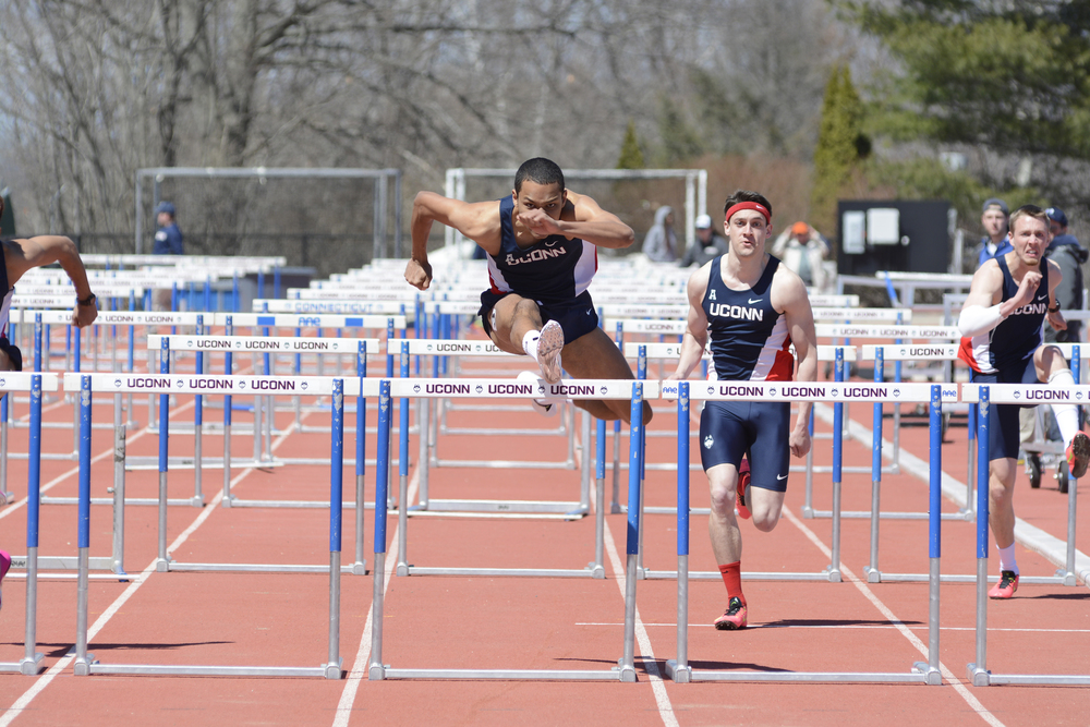 A UConn track and field athlete does the hurdles at a meet in April 2015. The Huskies are prepping for the 89th running of the Texas Relays. (Jason Jiang/The Daily Campus)