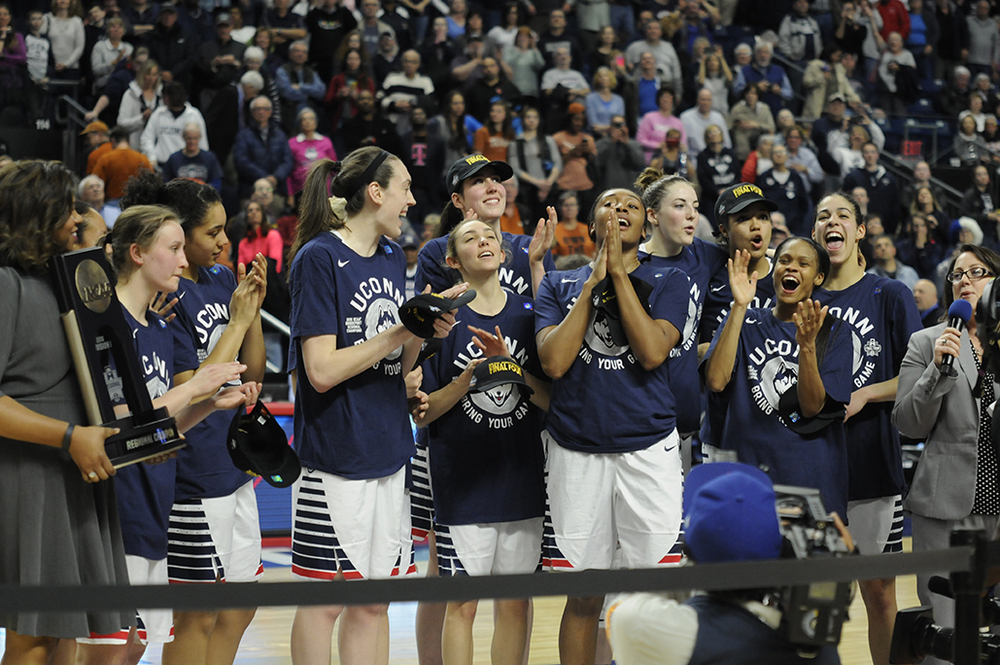 The UConn women's basketball team celebrates going to their ninth consecutive Final Four following their 86-65 victory over Texas at the Webster Bank Arena on Monday March 28, 2016. (Bailey Wright/The Daily Campus)