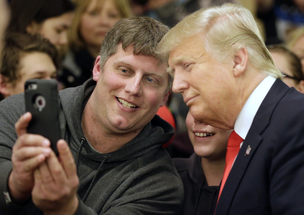 Mike Morrill takes a selfie with Republican presidential candidate Donald Trump during a rally Wednesday, March 30, 2016, at the Radisson Paper Valley Hotel in Appleton, Wis. (Wm. Glasheen/The Post-Crescent via AP)