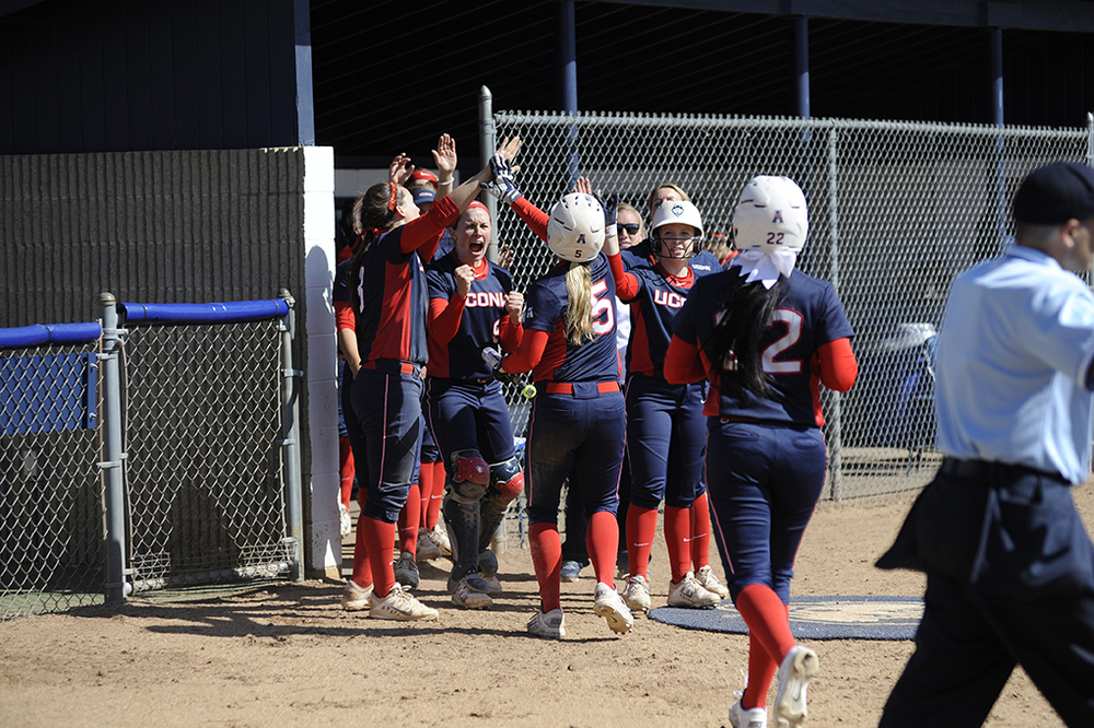 The UConn softball team celebrates after scoring a run during their victory over Bryant. The Huskies swept a double header at Burrill Family Field on Wednesday March 30, 2016. (Jason Jiang/The Daily Campus)