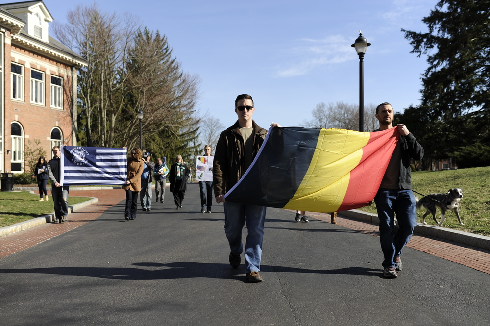 University of Connecticut student Samuel Surowitz leads the UConn Veteran Student Organization march to show solidarity with Brussels victims. (Jason Jiang/Daily Campus)
