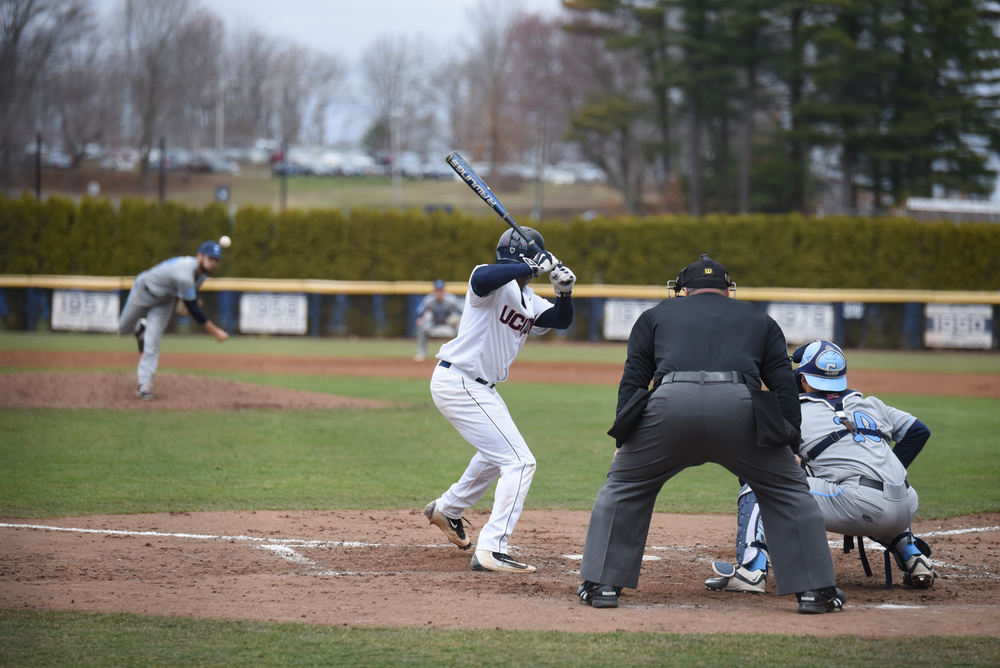 Aaron Hill (center) squares up to hit a pitch against Colombia during a game on Saturday, March 26 at J.O. Christian Field in Storrs. Hill went 2-for-4 with one run and one R.B.I. against Tulane on Friday. (Zhelun Lang/The Daily Campus)