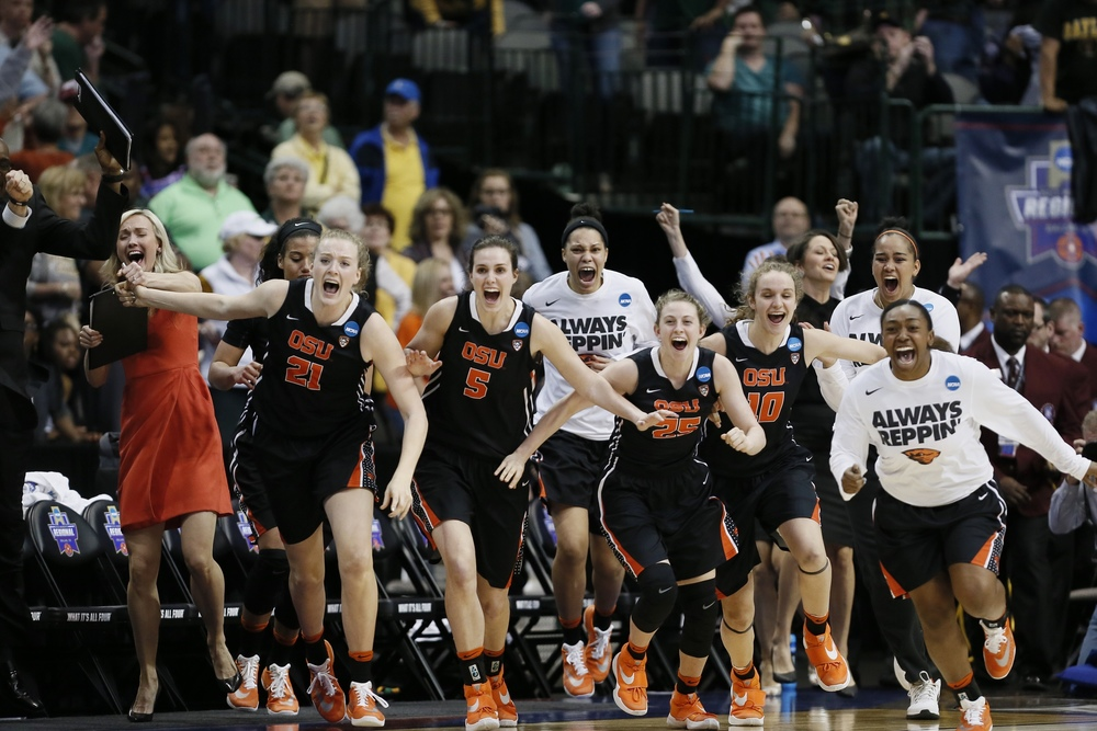 Oregon State rush the court in celebration of a 60-57 win over Baylor in a regional final of the women's NCAA college basketball tournament, Monday, March 28, 2016, in Dallas. (AP Photo/Brandon Wade)