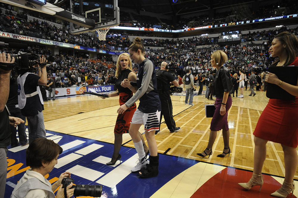 Katie Lou Samuelson walks off the floor in a walking boot after leaving UConn's 80-51 victory over Oregon State in the national semifinal at Lucas Oil Stadium in Indianapolis, Ind. on Sunday April 3, 2016. Samuelson left the game with an injury. It was announced that she broke a a bone in her left foot. She will miss the championship game on Tuesday night. (Bailey Wright/The Daily Campus)