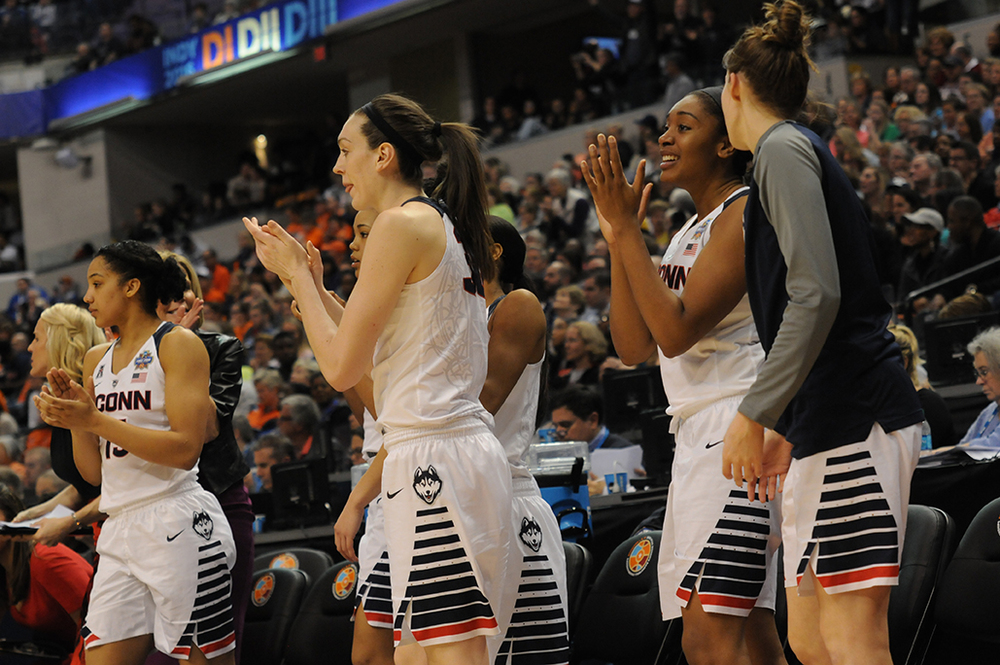 Players on the UConn bench celebrate during the closing moments of their victory over Oregon State in the national semifinal at Lucas Oil Stadium on Sunday April 3, 2016. UConn is looking for their fourth consecutive national championship on Tuesday when they face Syracuse. (Bailey Wright/The Daily Campus)