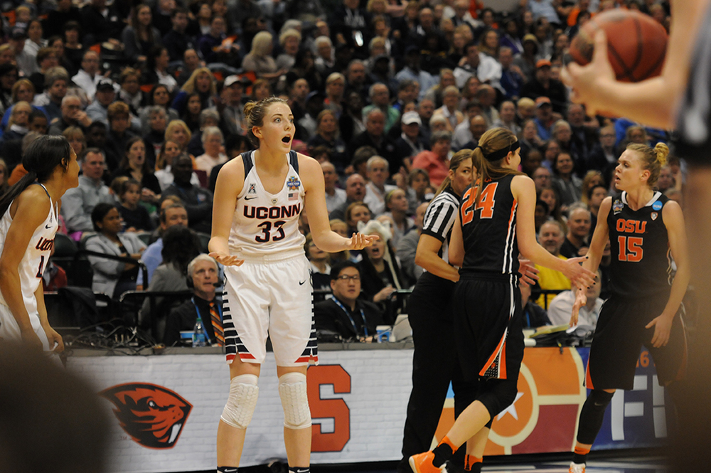 Freshman Katie Lou Samuelson looks on in disbelief during UConn's 80-51 victory over Oregon State in the national semifinal at Lucas Oil Stadium on Sunday April 3, 2016. Samuelson broke a bone in her left foot during the game, had to leave and will not play in the national championship game on Tuesday. (Bailey Wright/The Daily Campus)