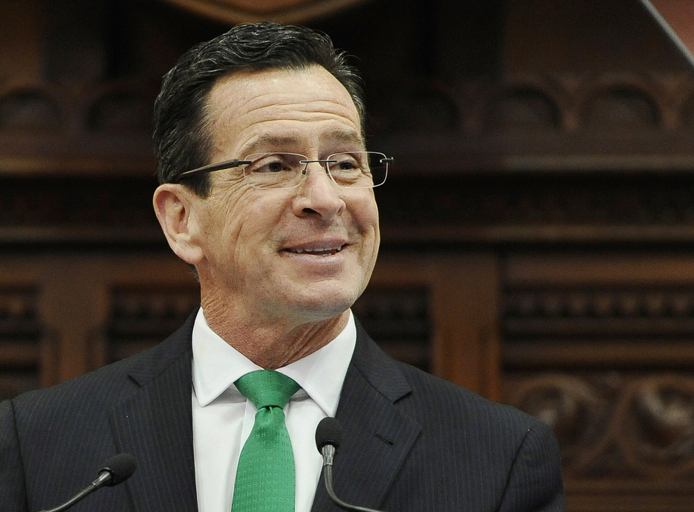 In this Jan. 7, 2015, file photo, Connecticut Gov. Dannel P. Malloy smiles during the State of the State address to a joint session of the legislature in the House Chambers at the Capitol in Hartford, Conn. (AP Photo/Jessica Hill, File)