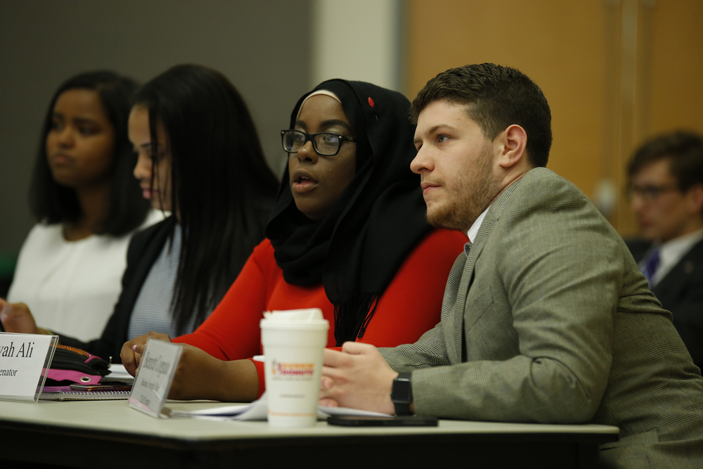 USG senators Haddiyyah Ali (left) and Bennett Cognato (right) pictured at a USG meeting in the UConn Student Union in Storrs, Connecticut on March 30, 2016. Ali authored the bill calling for UConn to revoke Bill Cosby's honorary degree, which he was awarded in 1996. (Tyler Benton/The Daily Campus)
