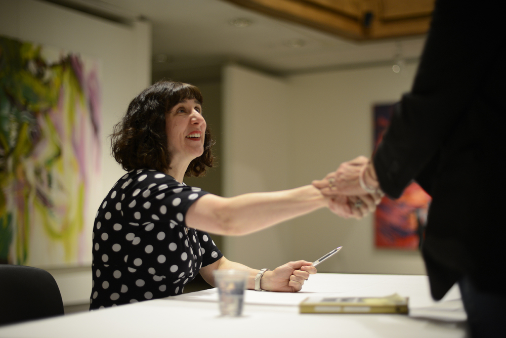 Sinéad Morrissey, an award-winning Irish poet and writer-in-residence at Queens University in Belfast, Northern Ireland, shakes hands with a fan after her lecture Tuesday, April 5 at the Benton Museum. (Jason Jiang/Daily Campus)