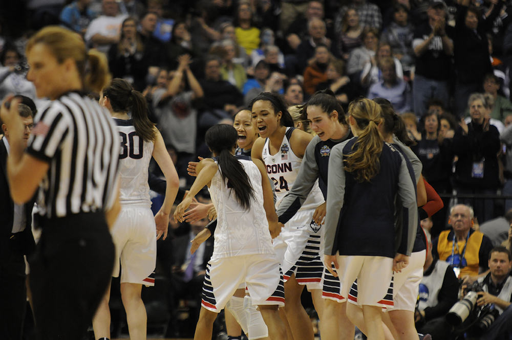 The UConn bench celebrates during the first half of the national championship game against Syracuse at Bankers Field House in Indianapolis, Ind. on Tuesday April 5, 2016. The Huskies won their fourth consecutive NCAA national championship. (Bailey Wright/The Daily Campus)