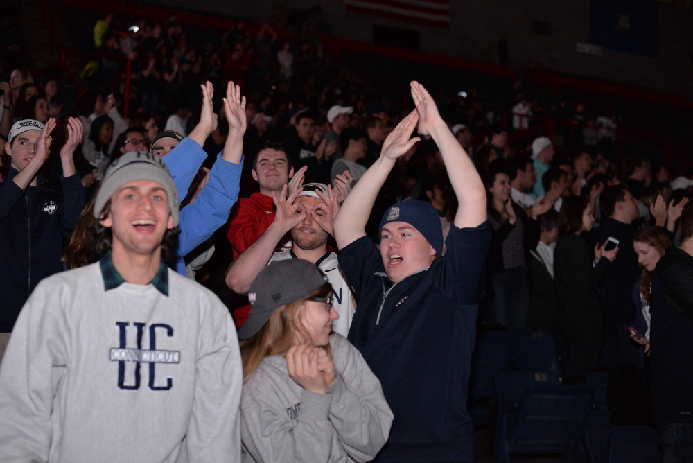 Students cheer in Gampel Pavillion at the screening of the NCAA women's championship game between UConn and Syracuse. The game was played at the Bankers Life Fieldhouse in Indianapolis, Ind., on Tuesday, April 5, 2016. (Amar Batra/Daily Campus)