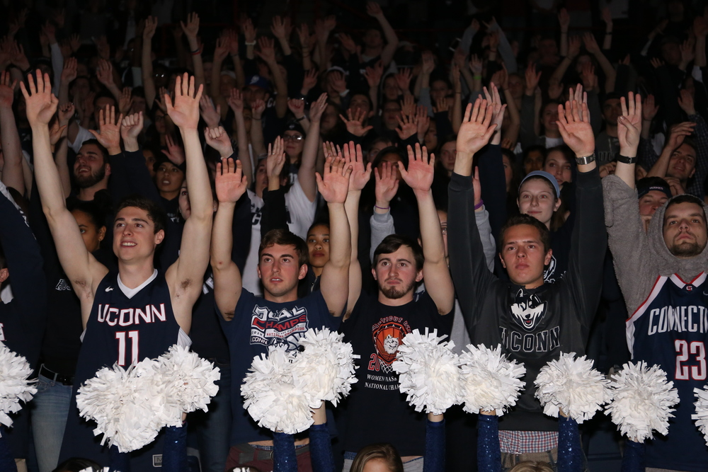 Students cheer in Gampel Pavillion at the screening of the NCAA women's championship game between UConn and Syracuse. The game was played at the Bankers Life Fieldhouse in Indianapolis, Ind., on Tuesday, April 5, 2016. (Jackson Haigis/Daily Campus)
