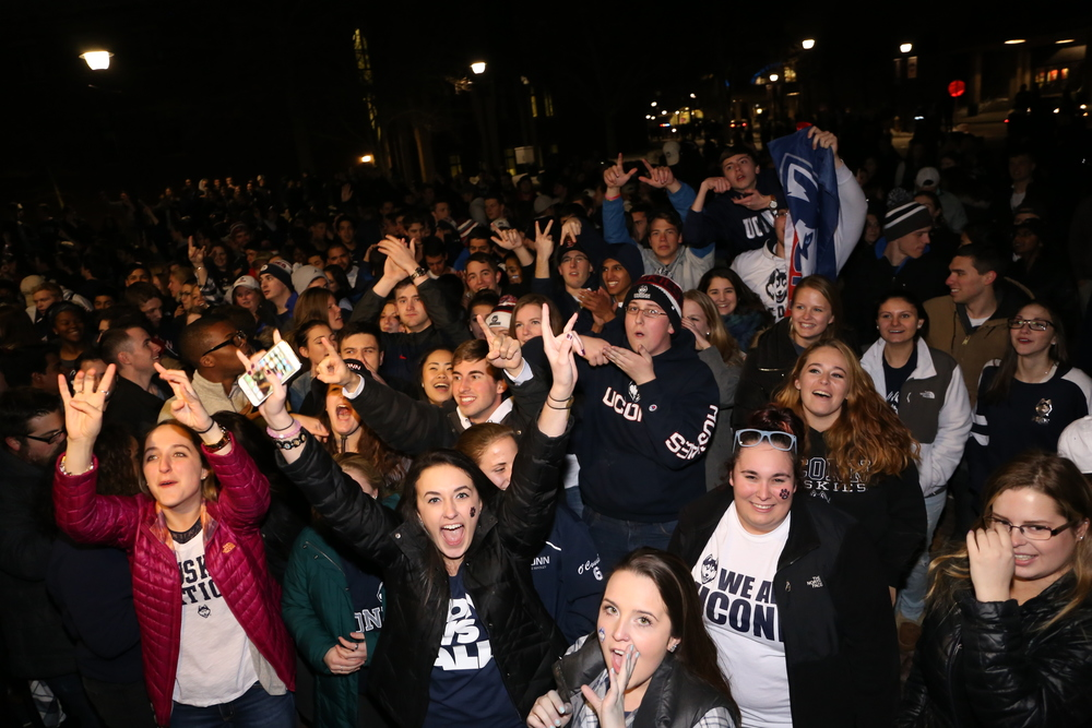 Students celebrate the UConn win outside Gampel Pavillion after the NCAA women's championship game between UConn and Syracuse. The game was played at the Bankers Life Fieldhouse in Indianapolis, Ind., on Tuesday, April 5, 2016. (Jackson Haigis/Daily Campus)