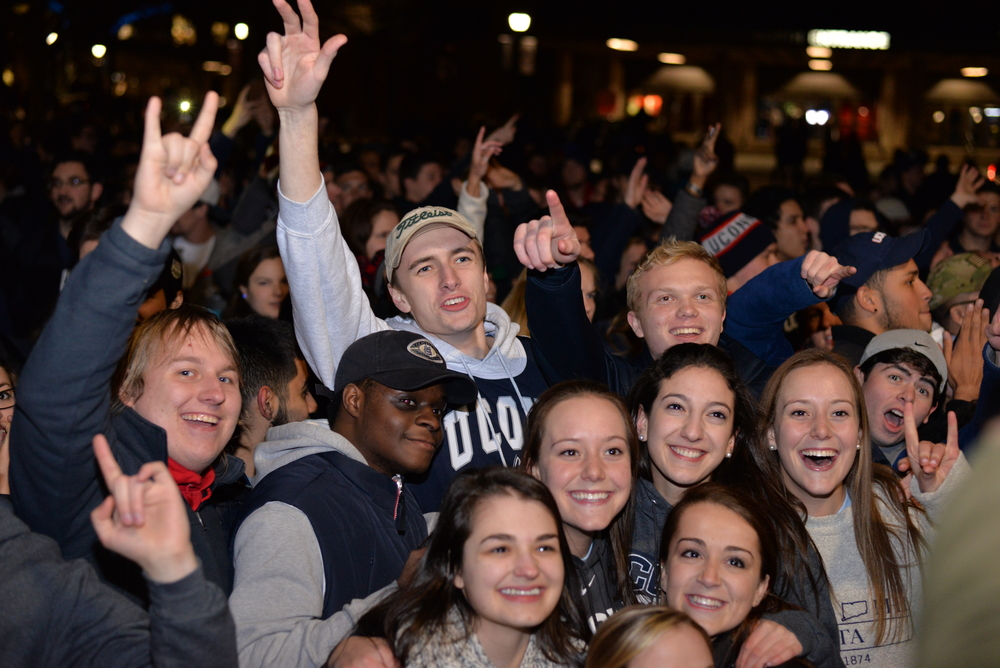 Students celebrate the UConn win outside Gampel Pavillion after the NCAA women's championship game between UConn and Syracuse. The game was played at the Bankers Life Fieldhouse in Indianapolis, Ind., on Tuesday, April 5, 2016. (Amar Batra/Daily Campus)